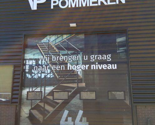 gebouw opknappen overhead deur opknappen building wrapping alternatief voor schilderen lelijke architectuur verbergen reclamebureau ede bunschoten-spakenburg